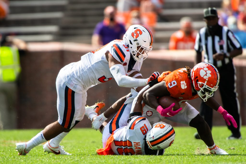 Clemson running back Travis Etienne(9) is tackled by Syracuse linebacker Geoff Cantin-Arku(31) and Syracuse defensive back Rob Hanna(19) during their game, Oct 24, 2020; Clemson, South Carolina, USA; at Memorial Stadium. Mandatory Credit: Ken Ruinard-USA TODAY Sports