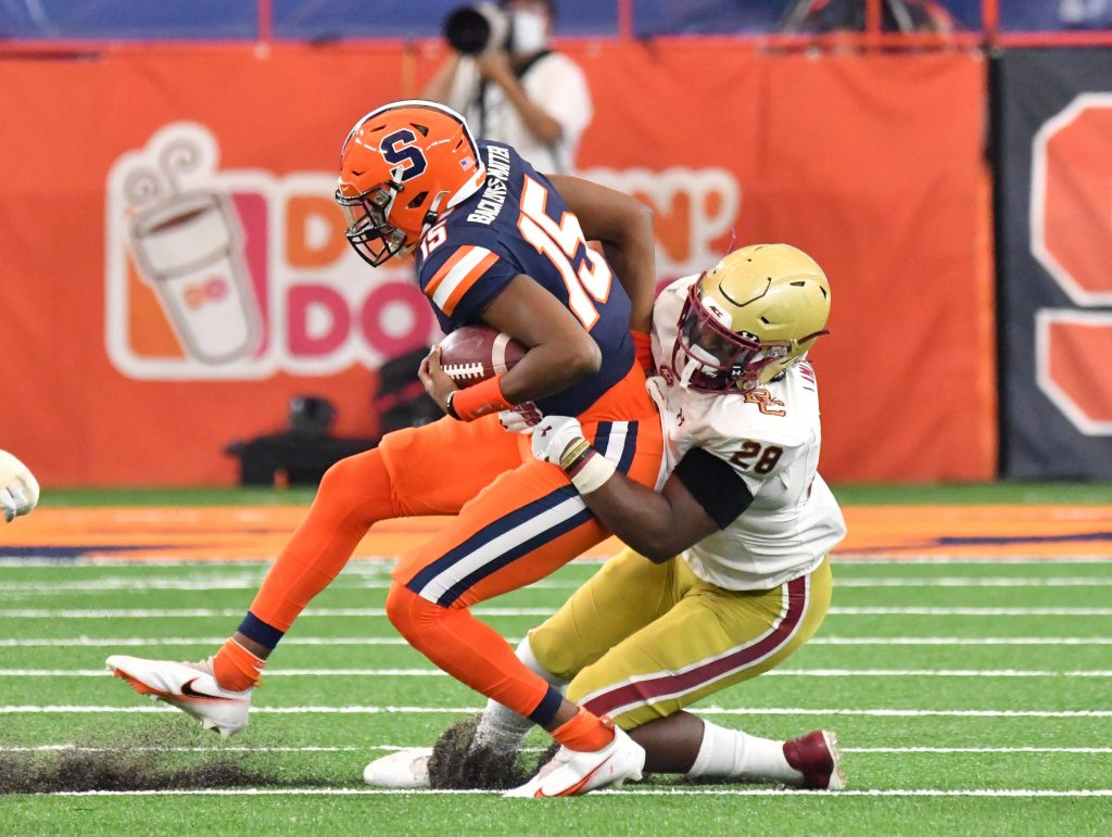Nov 7, 2020; Syracuse, New York, USA; Syracuse Orange quarterback JaCobian Morgan (15) is tackled by Boston College Eagles linebacker John Lamot (28) in the second quarter at the Carrier Dome. Mandatory Credit: Mark Konezny-USA TODAY Sports