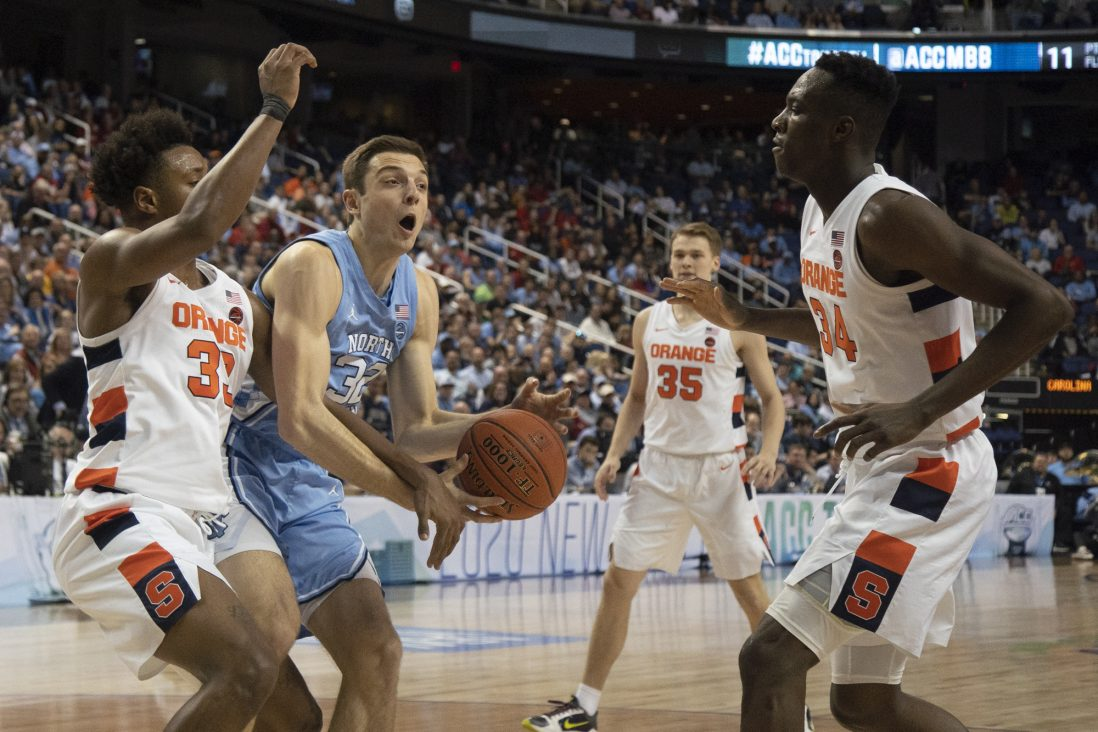 UNC graduate forward Justin Pierce (32) fights for possession of the ball against Syracuse in the second round of the 2020 New York Life ACC Tournament held in the Greensboro Coliseum in Greensboro, N.C., on Wednesday, March 11, 2020. UNC lost 81-53.