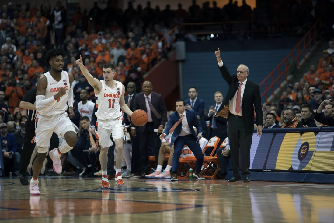 Syracuse's Joe Girard III and Qunicy Guerrier make their way down the court.