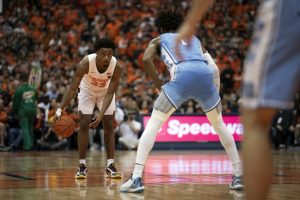 Syracuse's Elijah Hughes prepares to make a drive while covered by North Carolina #1 Leaky Black.