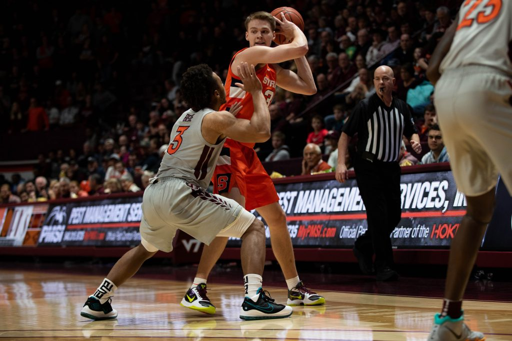 Syracuse's Buddy Boeheim fends off Wabissa Bede of Virginia Tech on Jan. 18 in Blacksburg, Va.