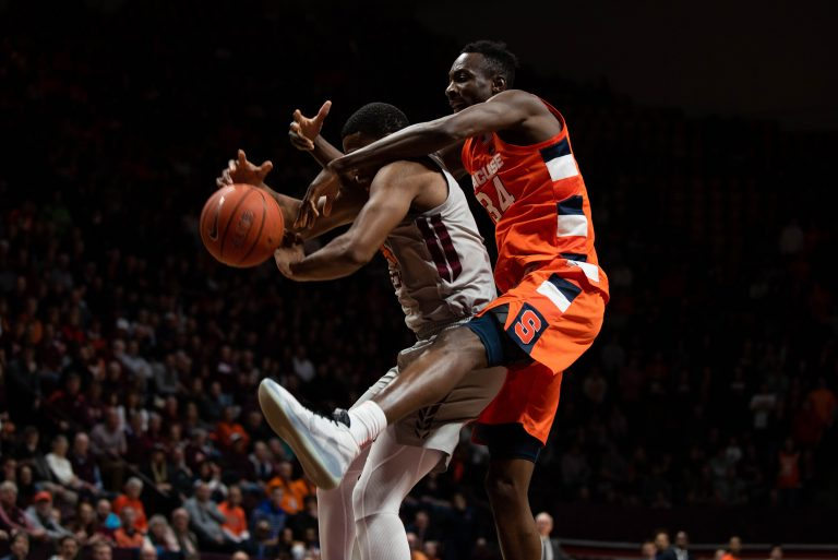 Nahiem Alleyne (4) grabs the rebound from Bourama Sidibe (34) on Jan. 18, 2020 in Blacksburg, Va.