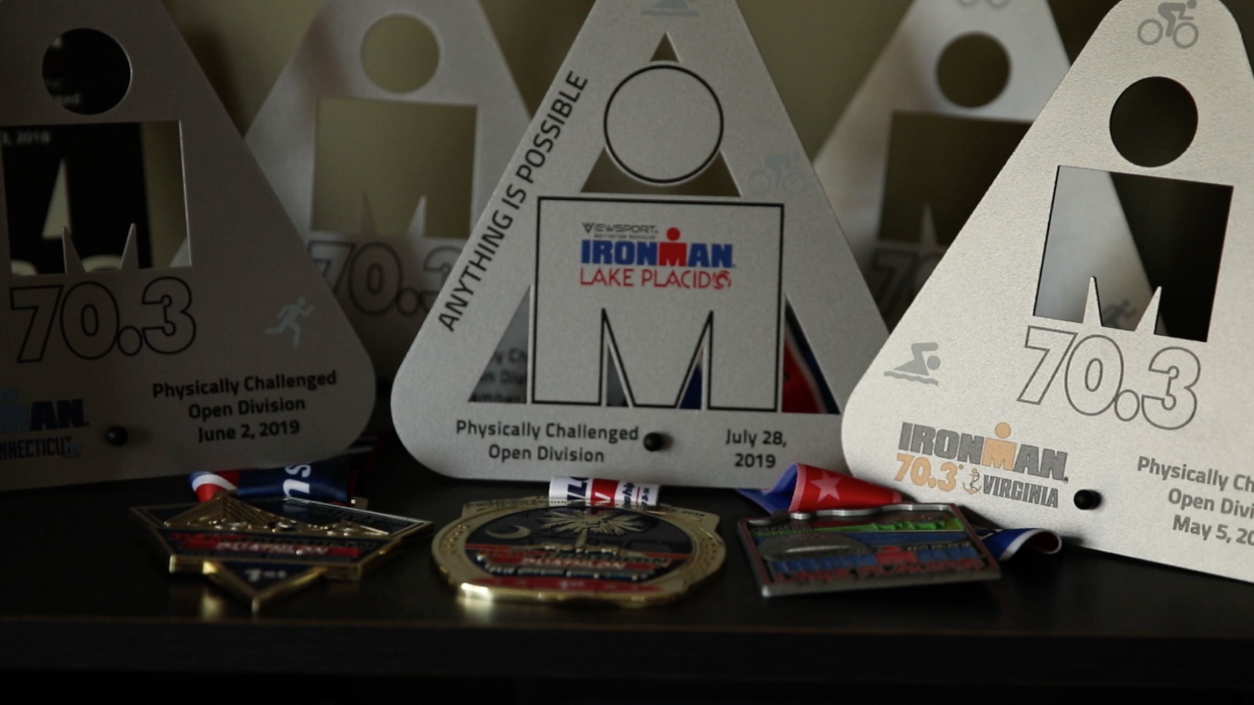 Ironman and race medals that paratriathlete Ulf Oesterle has won.