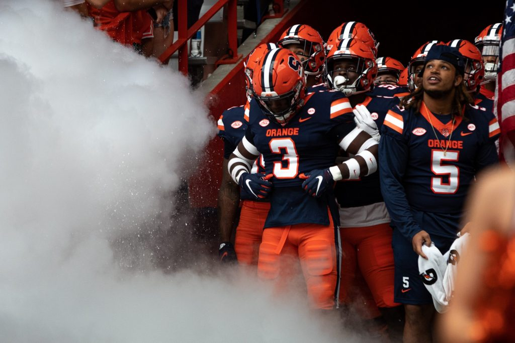 ed by Taj Harris (3), the Syracuse football team awaits in the tunnel to hit the field before an NCAA football game against Rutgers, Saturday, at the Carrier Dome.