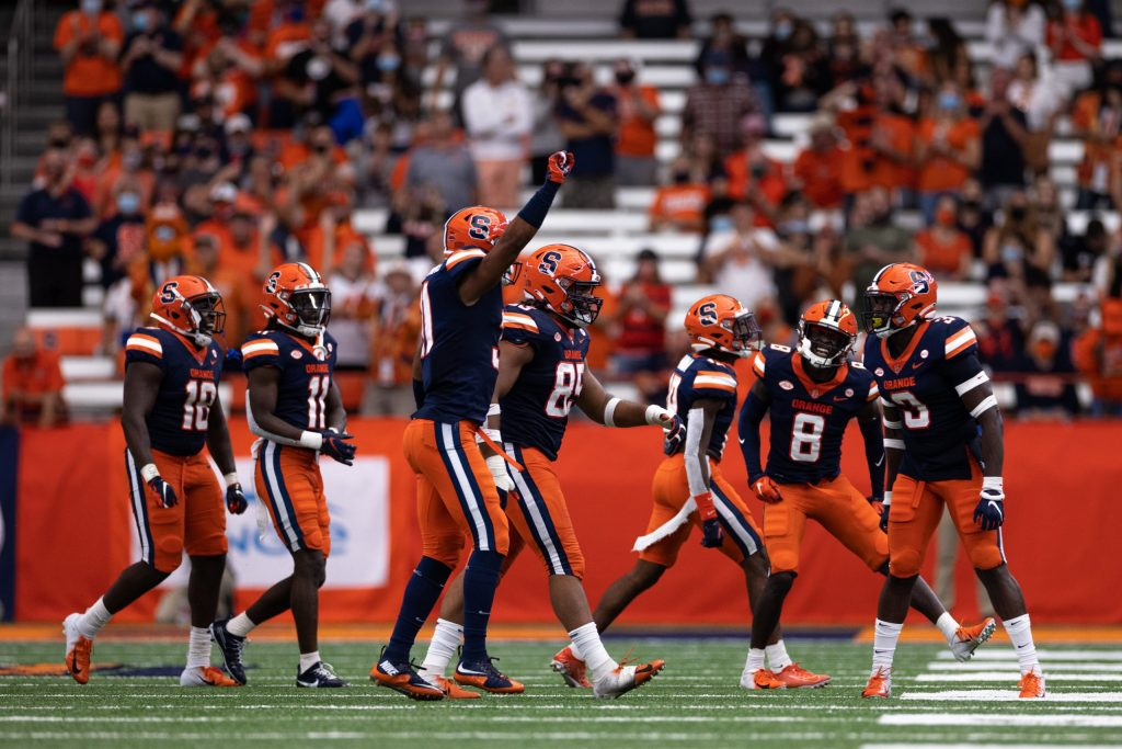 Members of the Syracuse defense celebrate with the crowd.
