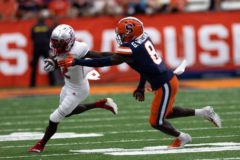 Syracuse's Garrett Williams (8) tries to wrap up Rutgers' Aron Cruickshank after he made a catch during an NCAA football game, Saturday, at the Carrier Dome.