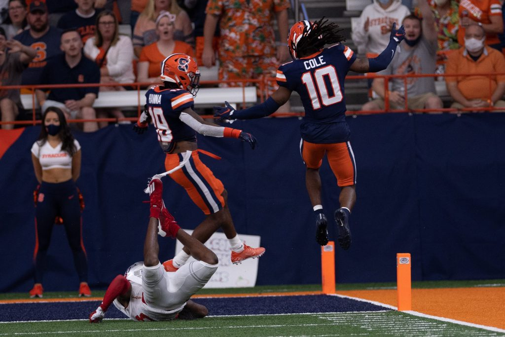 Syracuse's Adrian Cole (10) and Rob Hanna (19) go airborne after teaming up to force an incompletion against Rutgers during an NCAA football game, Saturday, at the Carrier Dome.