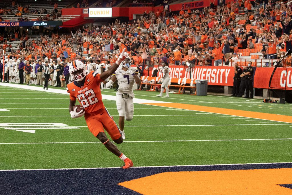 Syracuse University wide receiver Damien Alford (82) runs into the end zone for a touchdown.