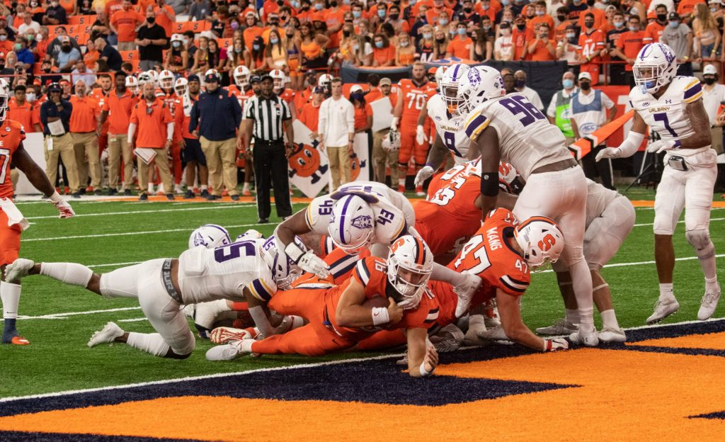 Syracuse University quarterback Garrett Shrader (16) lunges into the endzone for a touchdown during a NCAA football game at the Carrier Dome, Saturday, against University of Albany.