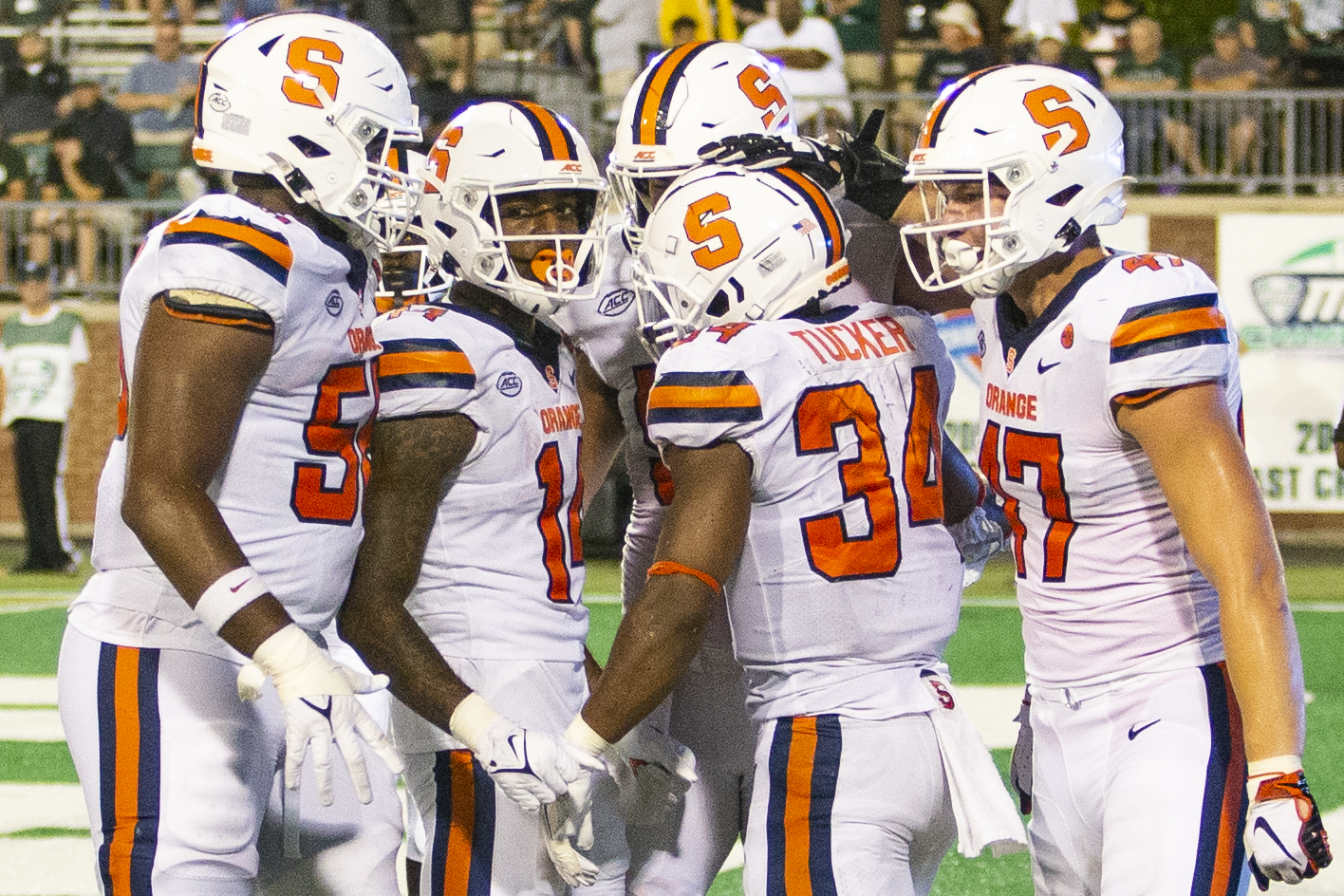 Syracuse's Orange players celebrate a touchdown during the Syracuse versus Ohio match in Athens, Ohio, on Saturday, Sep. 4, 2021. Syracuse won 29-9.