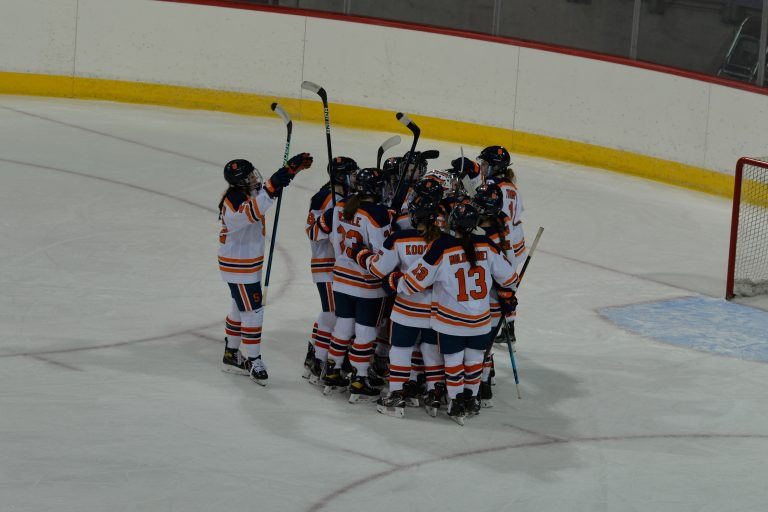 Syracuse women's ice hockey celebrates after beating Lindenwood 6-0 in the first round of the 2021 CHA Tournament.
