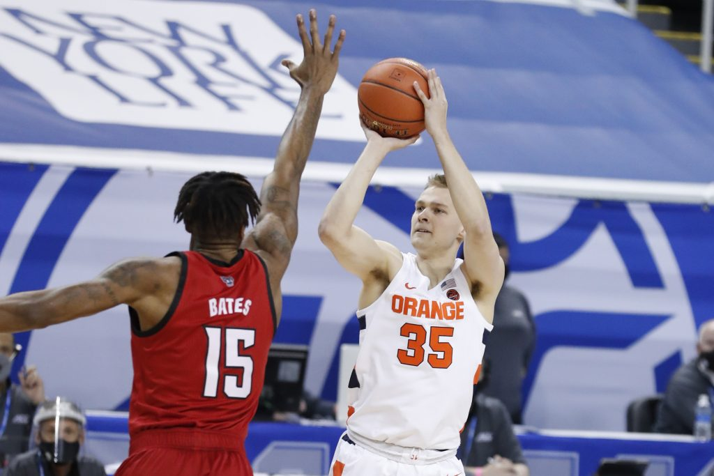 Buddy Boeheim (35) shoots over a defender during the first half of N.C. State's game against Syracuse in the second round of the ACC Men's Basketball Tournament in Greensboro, N.C., Wednesday, March 10, 2021.