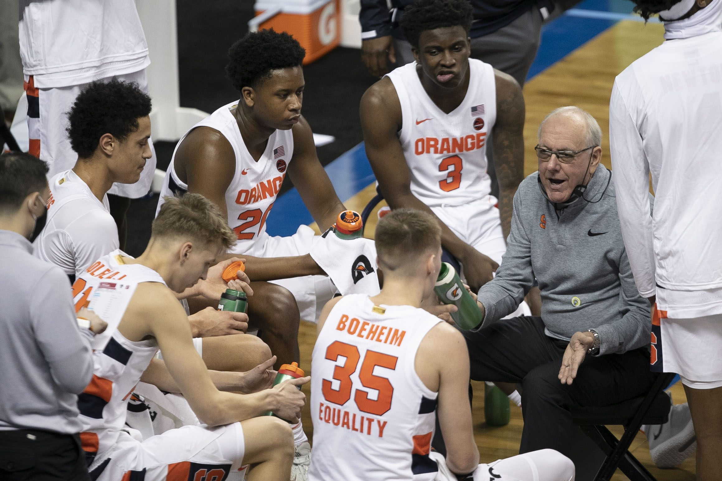 Syracuse coach Jim Boeheim talks with his players during a time-out in the first half against N.C. State on Wednesday, March 10, 2021 during the ACC Tournament at the Greensboro Coliseum in Greensboro, N.C.