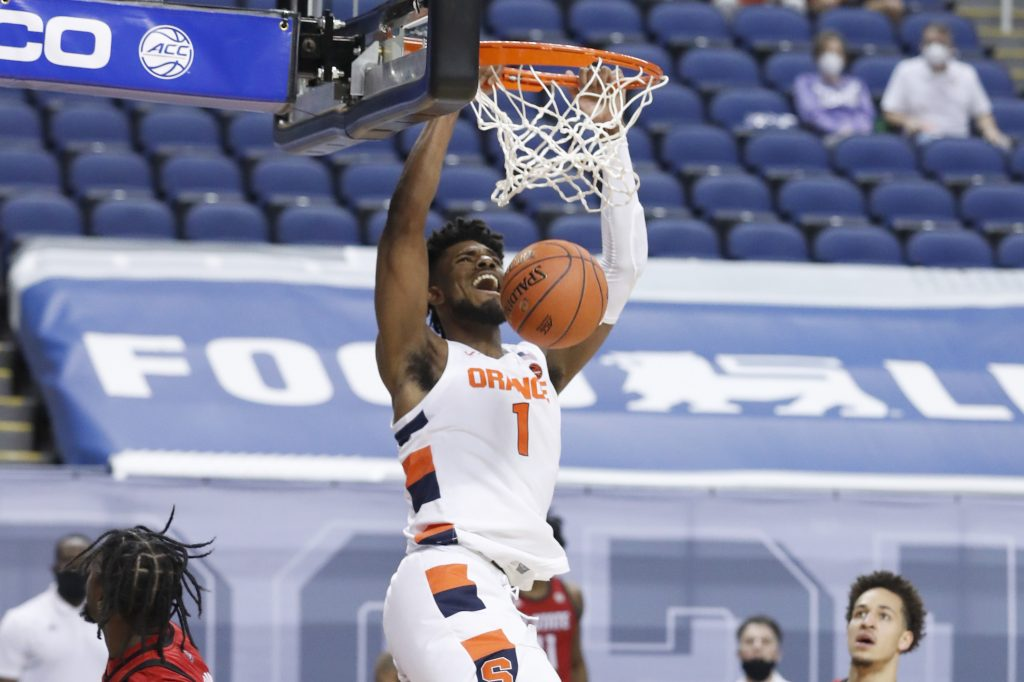 Syracuse's Quincy Guerrier (1) slams in two during the first half of N.C. State's game against Syracuse in the second round of the ACC Men's Basketball Tournament in Greensboro, N.C., Wednesday, March 10, 2021.