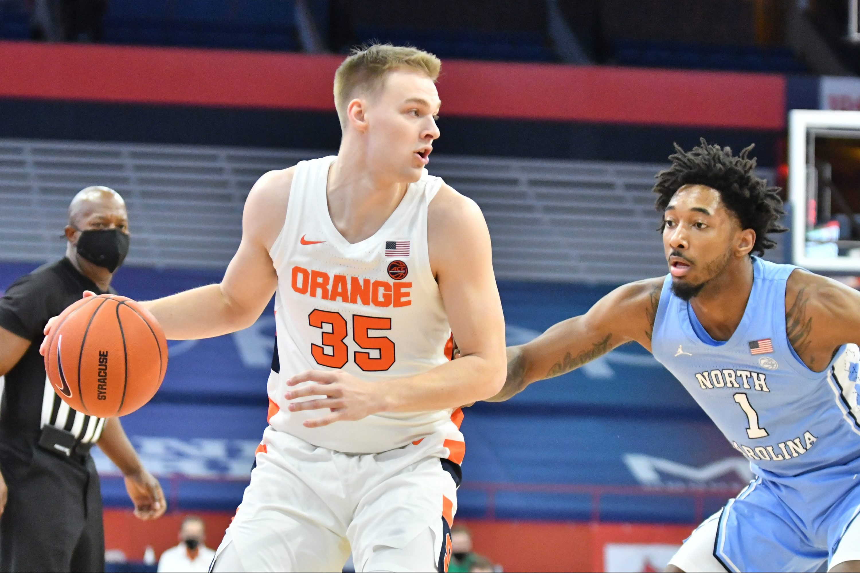 Mar 1, 2021; Syracuse, New York, USA; Syracuse Orange guard Buddy Boeheim (35) tries to get the ball past North Carolina Tar Heels guard Leaky Black (1) in the first half at the Carrier Dome. Mandatory Credit: Mark Konezny-USA TODAY Sports