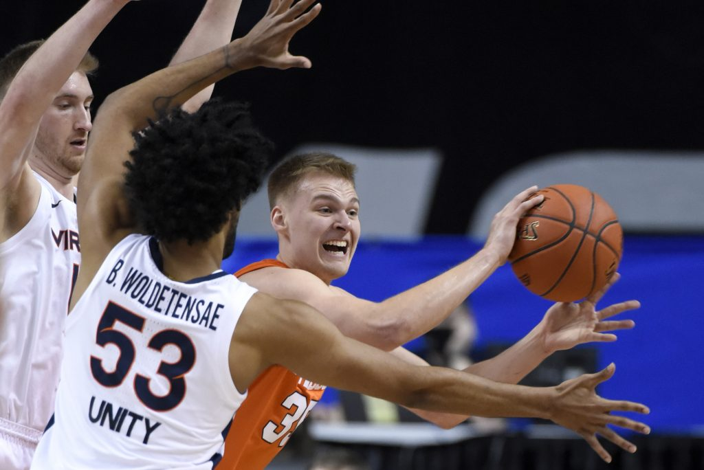 Syracuse guard Buddy Boeheim (35) is pressured by Virginia during the 2021 New York Life ACC Men's Basketball Tournament in Greensboro, N.C., Thursday, March 11, 2021.