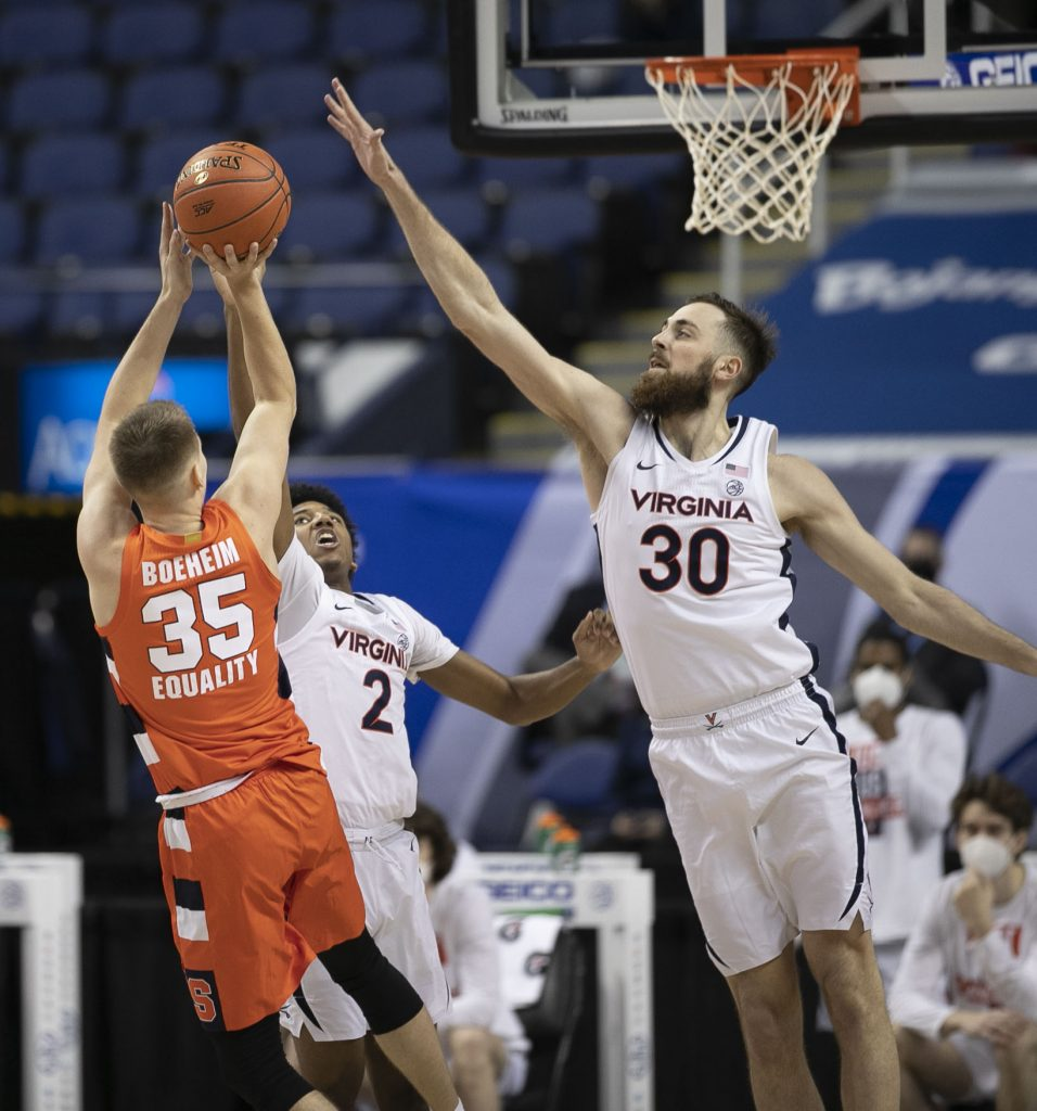 Syracuse's Buddy Boeheim (35) puts up a shot over Virginia's Jay Huff (30) during the first half on Thursday, March 11, 2021 during the ACC Tournament at the Greensboro Coliseum in Greensboro, N.C.