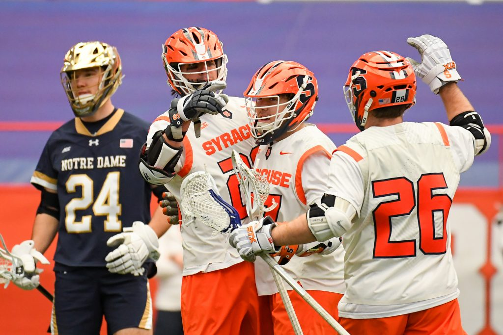 Syracuse Orange attackman Stephen Rehfuss (29) celebrates his goal with teammates against the Notre Dame Fighting Irish during the first half at the Carrier Dome.