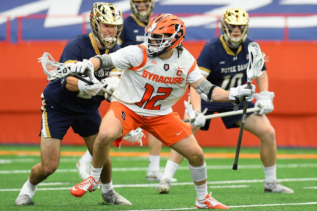 Syracuse Orange midfielder Jamie Trimboli (12) dodges to the goal against the Notre Dame Fighting Irish during the first half at the Carrier Dome.