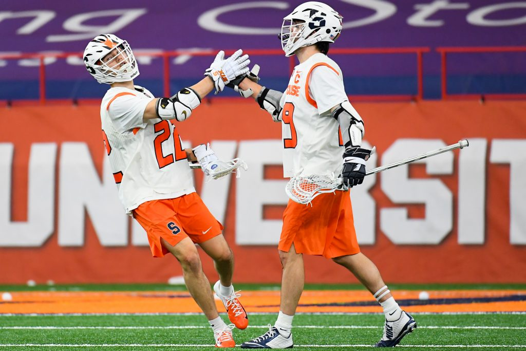 Syracuse Orange attackman Chase Scanlan (22) and attackman Stephen Rehfuss (29) celebrate a goal against the Vermont Catamounts during the first half at the Carrier Dome.