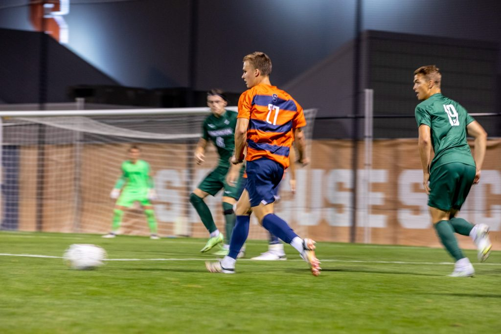 Syracuse Men's Soccer player Aidan Arber lays the ball inside during their 7-0 win versus Binghamton on September 14th, 2021.
