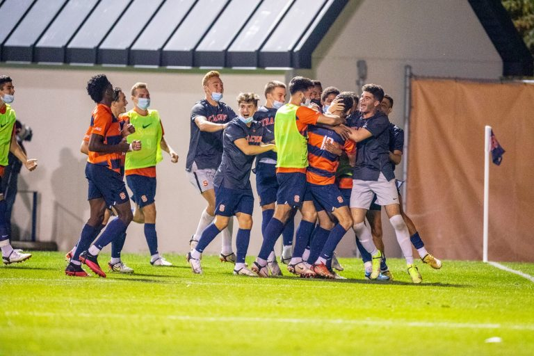 Syracuse Men's Soccer team celebrates after one of their seven goals they scored against Binghamton on September 14th, 2021.