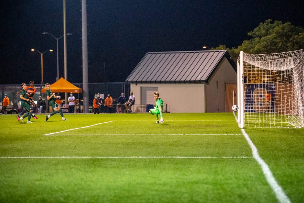Syracuse's Deandre Kerr smashes the ball to the right of the goalie, scoring one of two goals on the night of September 14th, 2021.