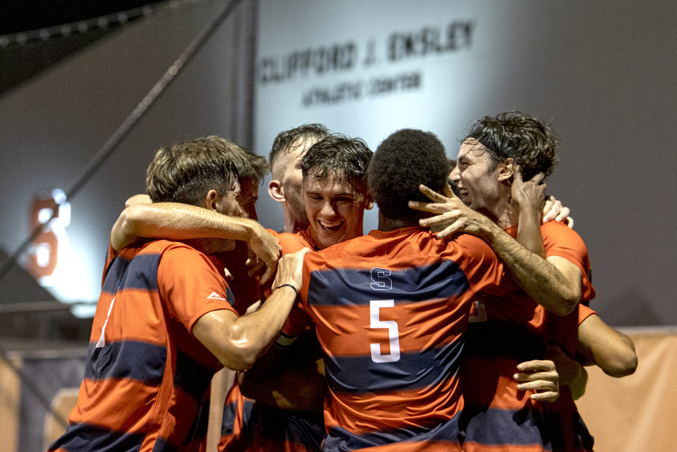 The Syracuse men's soccer team celebrates after junior defenseman Christian Curti's goal during its season opener against Drexel at the SU Soccer Stadium, August 26.