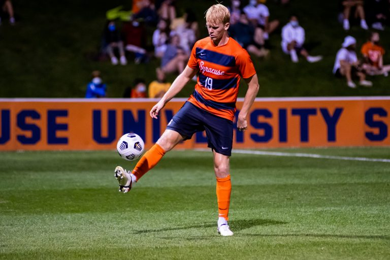 Syracuse's Buster Sjoberg (19) settles down a ball in the midfield during a men's Soccer vs. Louisville Cardinals on Sept. 17, 2021 at SU Soccer Stadium.