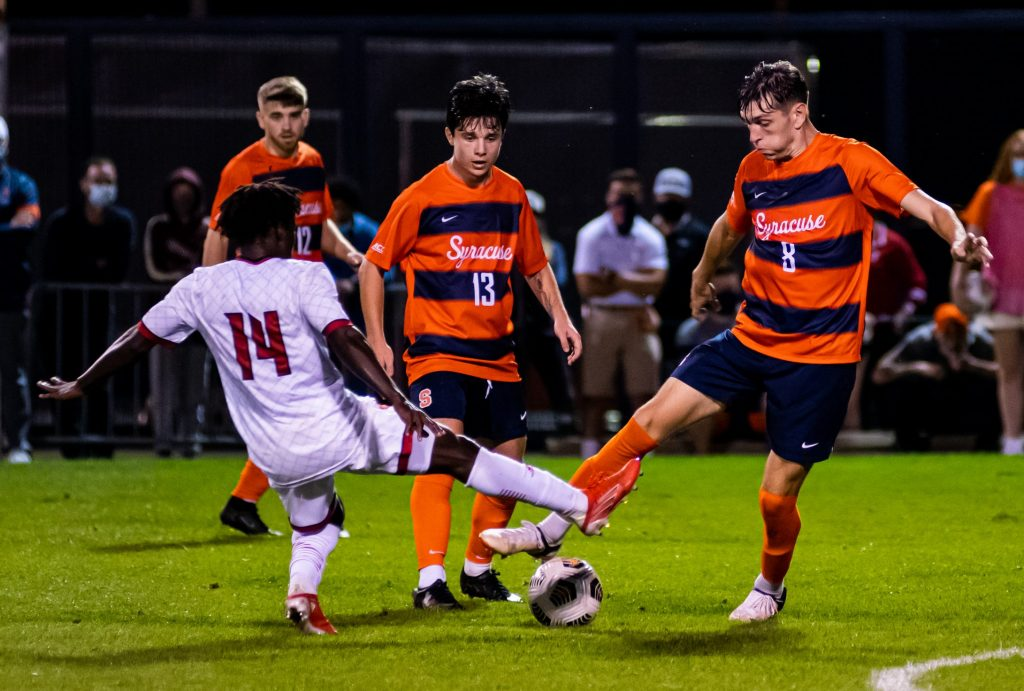 Syracuse's Georgia Kocevski (8) and Louisville's Eric Danquah (14) try and graduate possession simultaneously as Syracuse's Colin Biros (13) looks on.
