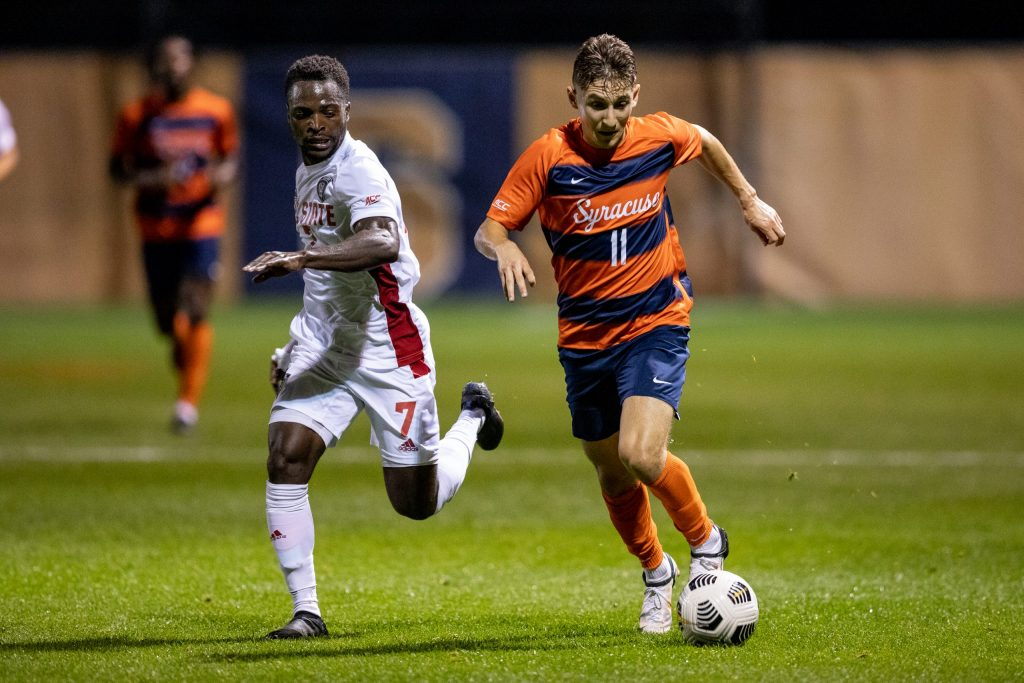 Syracuse Men's Soccer midfielder Hilli Goldhar drives past a NC State player in the 0-0 draw on Friday night.