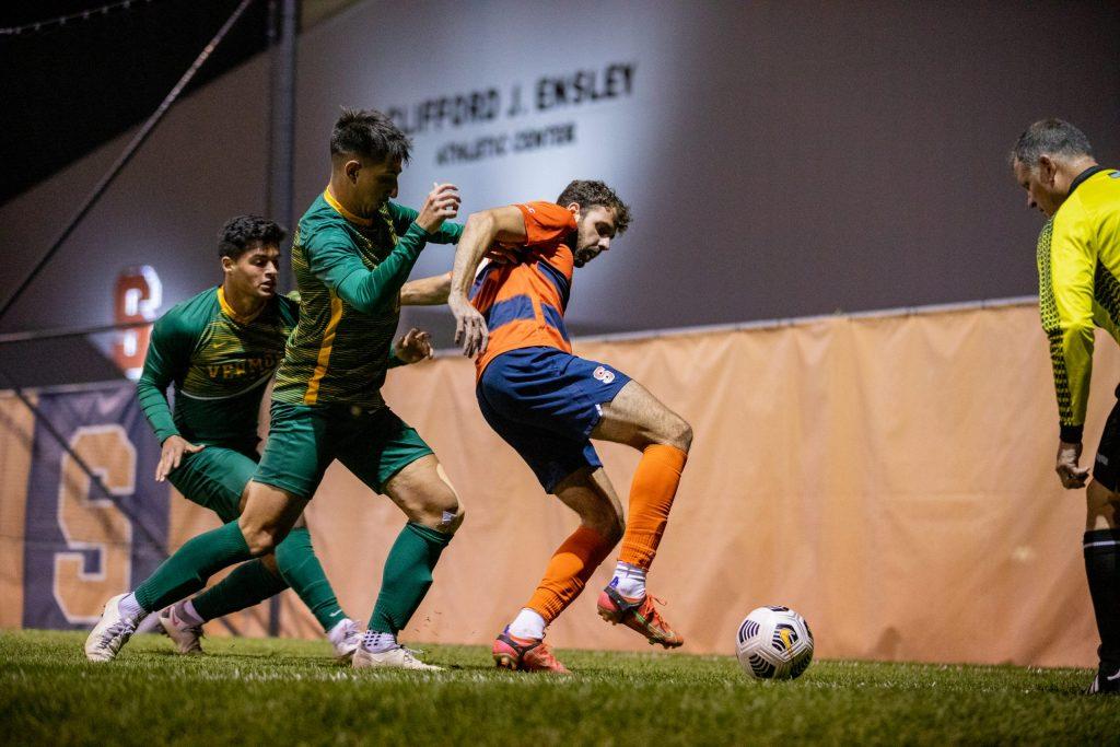 Manel Busqets (10) battles for possession during the Syracuse University Men's Soccer game vs UVM.
