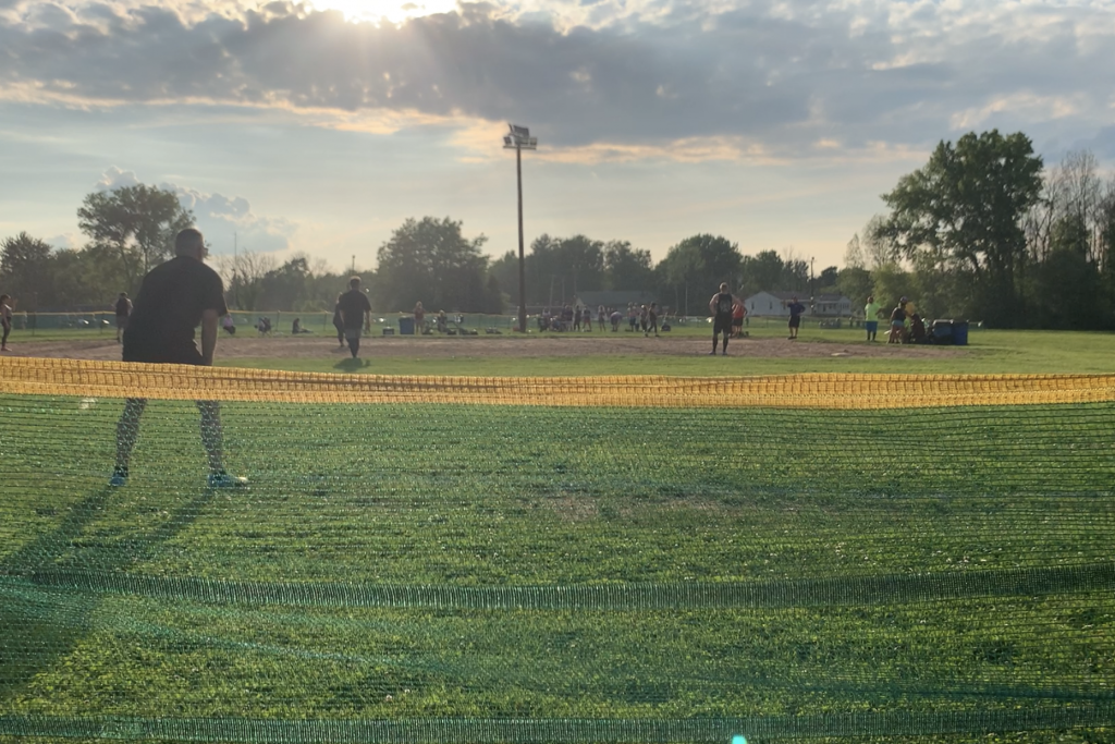 Outfielders guard the fence from fly balls on the diamond at the SSA Kickball Park.