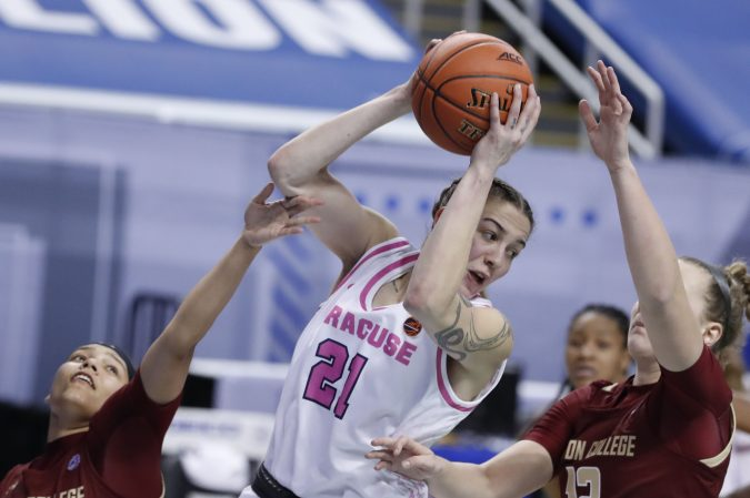 Syracuse forward Emily Engstler (21) grabs a rebound