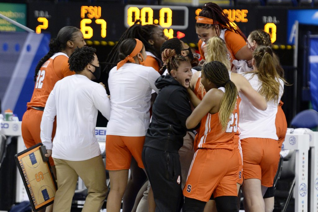 The Orange celebrate after being Florida State on a buzzer beater during the 2021 New York Life ACC Women's Basketball Tournament.