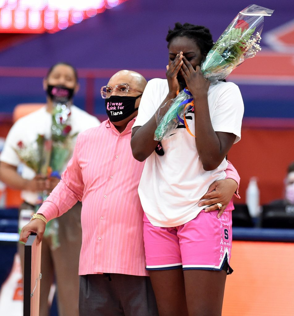 Syracuse women's coach Quentin Hillsman and Syracuse Orange forward Maeva Djaldi-Tabdi (3) hug as her highlight video is played on senior day. The Syracuse women's basketball team take on N.C. State at the Carrier Dome in Syracuse, N.Y. Feb 28, 2021