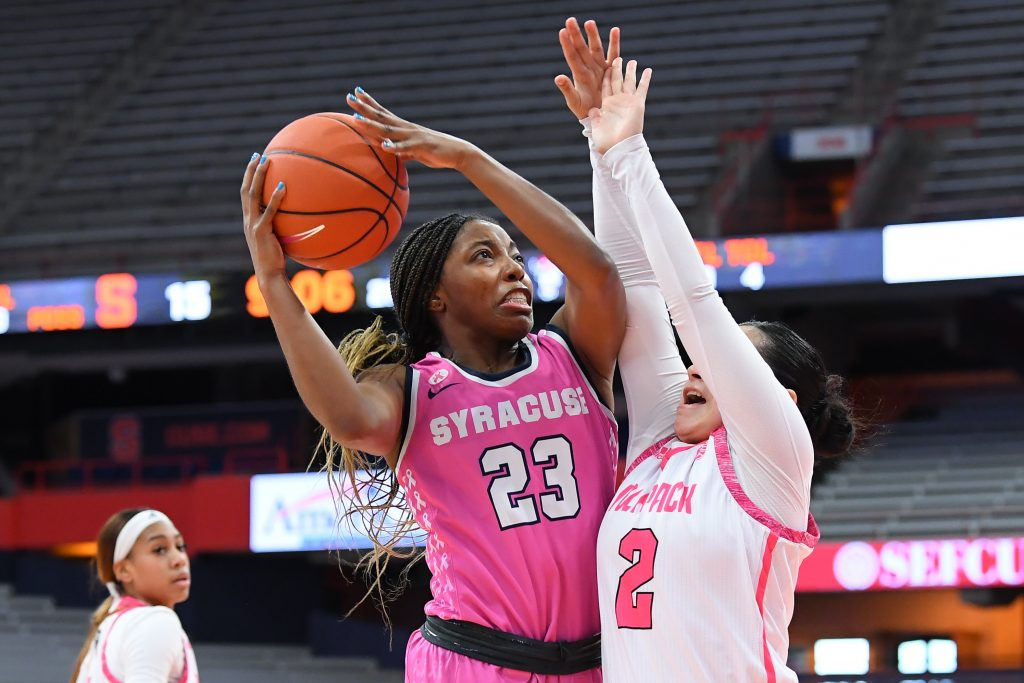 Feb 28, 2021; Syracuse, New York, USA; Syracuse Orange guard Kiara Lewis (23) shoots the ball against the defense of NC State Wolfpack guard Raina Perez (2) during the first half at the Carrier Dome. Mandatory Credit: Rich Barnes-USA TODAY Sports