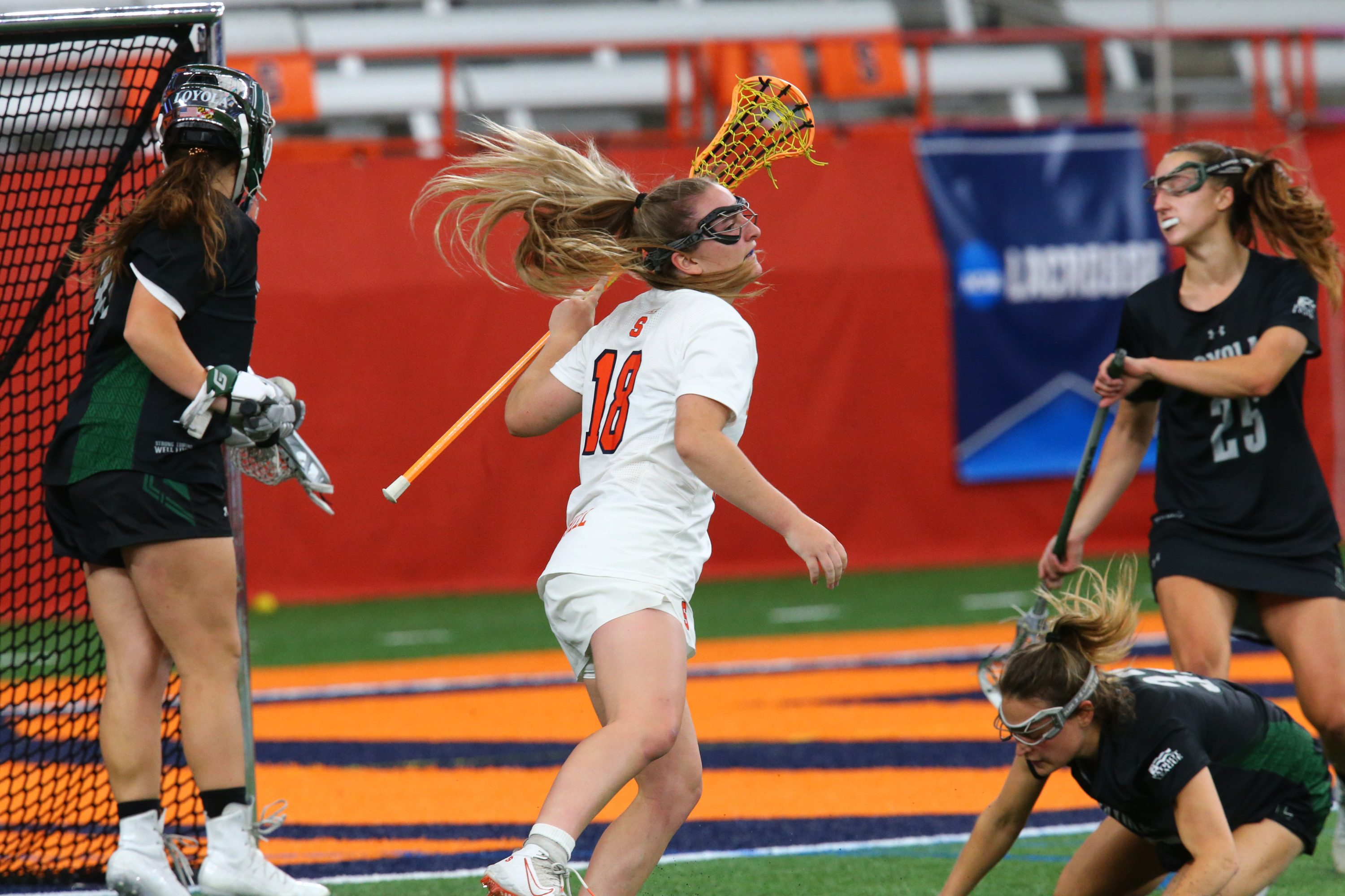 Meaghan Tyrrell (18) scores one of her seven goals against Loyola in the second round of the NCAA Tournament.