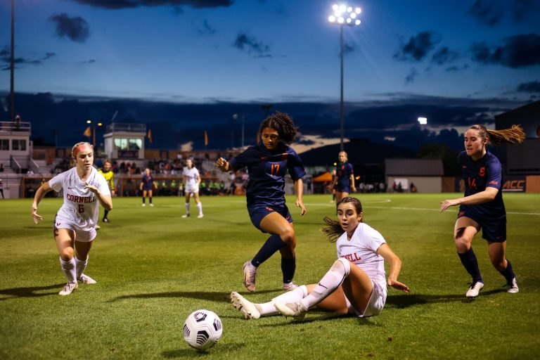 [Left to Right] Cornell's Ashley Durik, Syracuse's Kylen Grant, Cornell's Evanthia Spyredes and Syracuse's Kate Murphy chase the ball after it was blocked by Spyredes during a Women's Soccer game at SU Soccer Stadium on September 9, 2021.
