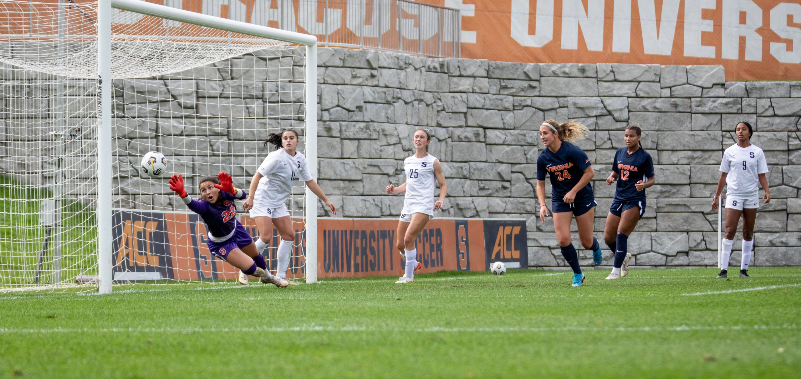 The ball flies past Syracuse's net-minder, Lysianne Proulx, for one of Virginia's five goals in the emphatic win over Syracuse on Sunday, October 10th, 2021.