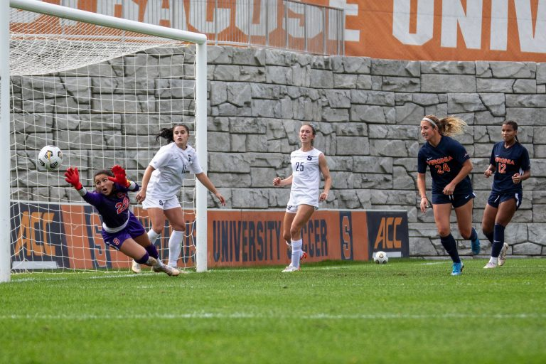 The ball flies past Syracuse's net-minder, Lysianne Proulx, for one of Virginia's five goals in the emphatic win over Syracuse on Sunday, October 10th, 2021..