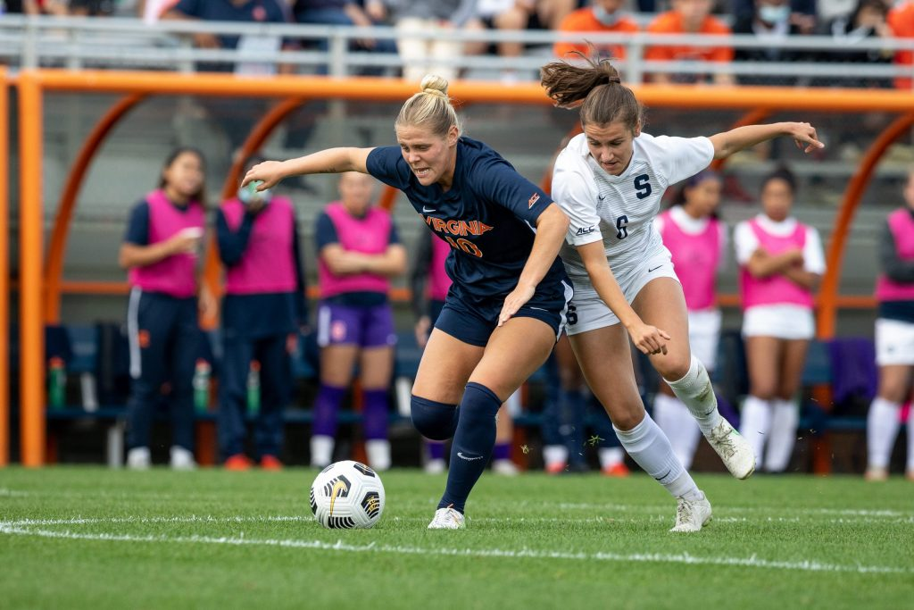 Syracuse Women's soccer player Pauline Matchens battles Virginia's Taryn Torres for the ball in the their matchup on Sunday, October 10th, 2021.