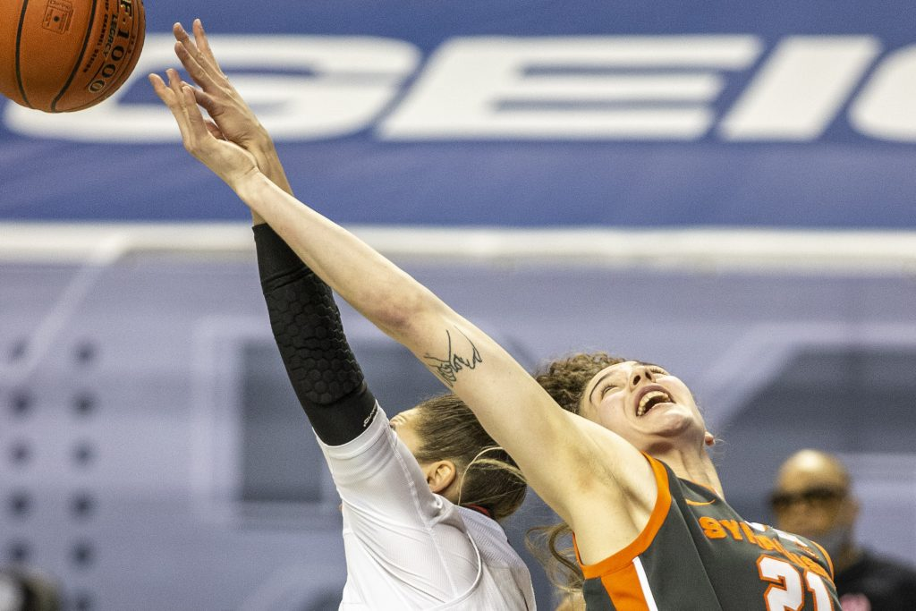 Syracuse's Emily Engstler reaches for a rebound during an NCAA college basketball game with Louisville in the Atlantic Coast Conference tournament at the Greensboro Coliseum in Greensboro, N.C., on Saturday, March 6, 2021.