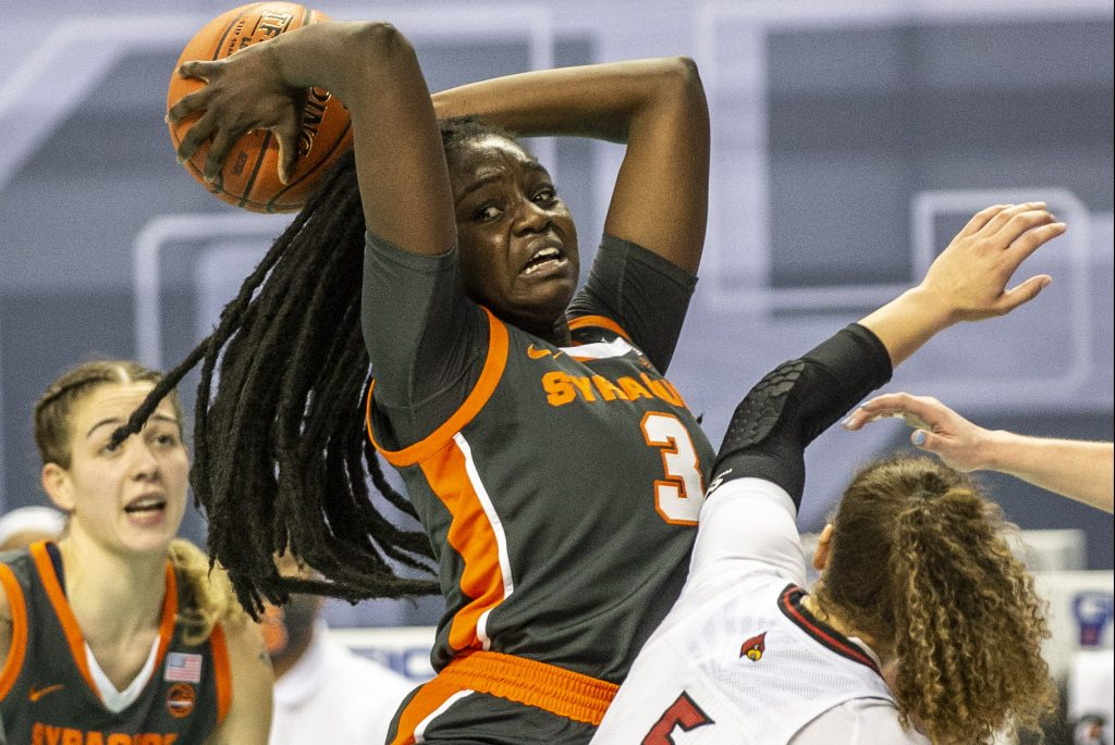 Syracuse's Maeva DjaldiÐTabdi pu lls down an offensive rebound during an NCAA college basketball game with Louisville in the Atlantic Coast Conference tournament at the Greensboro Coliseum in Greensboro, N.C., on Saturday, March 6, 2021.
