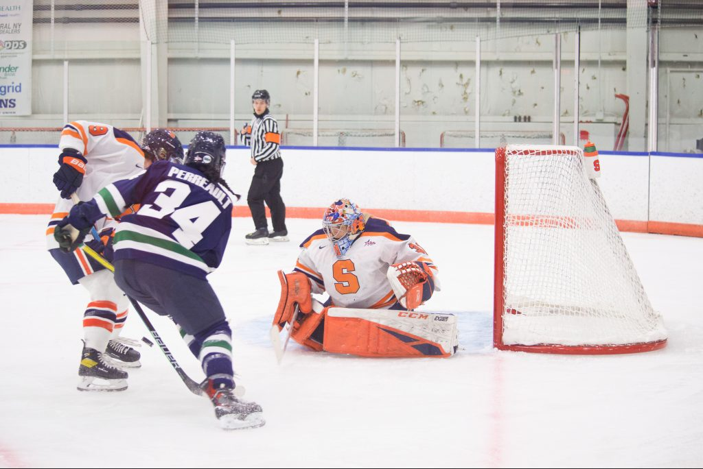 Allison Small keeps her eye on the puck as Mercyhurst's Liliane Perreault drives to the net.