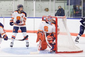 Allison Small defends the net in Syracuse's game against Penn State.