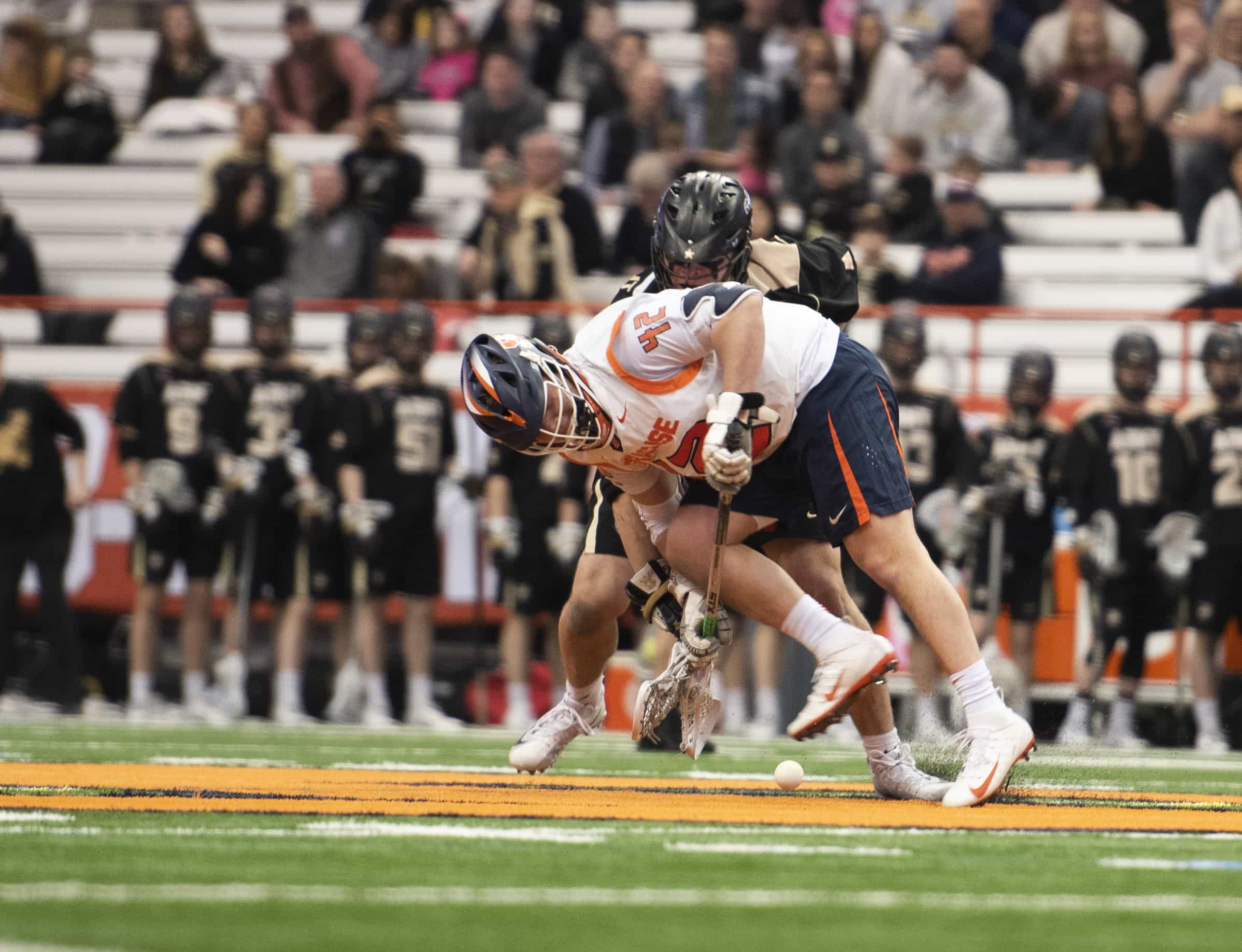 Junior Danny Varello contests for the ball during the faceoff during SU's 10-8 win over Army.