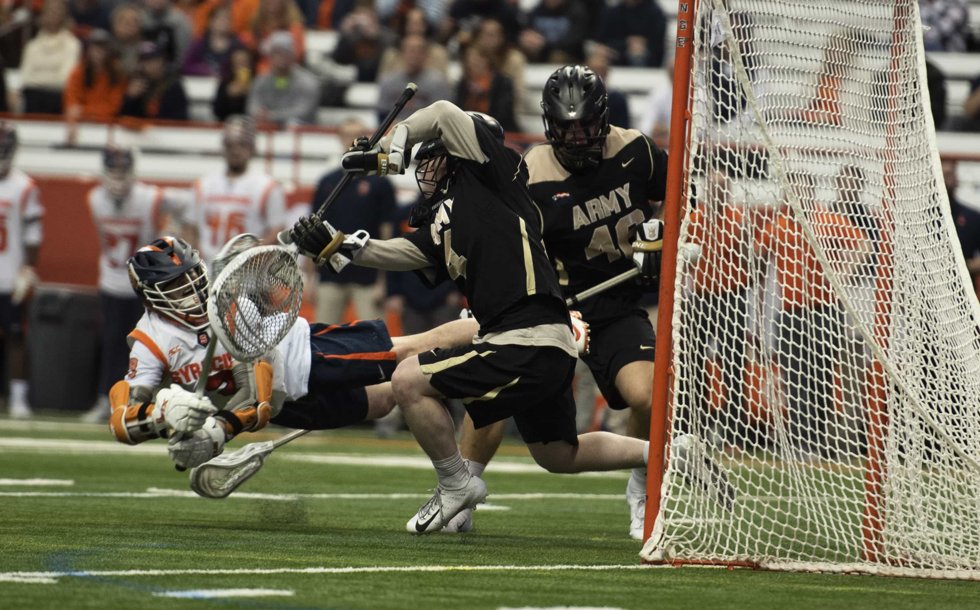 Senior Nate Solomon scores a diving goal during SU's 10-8 over Army.