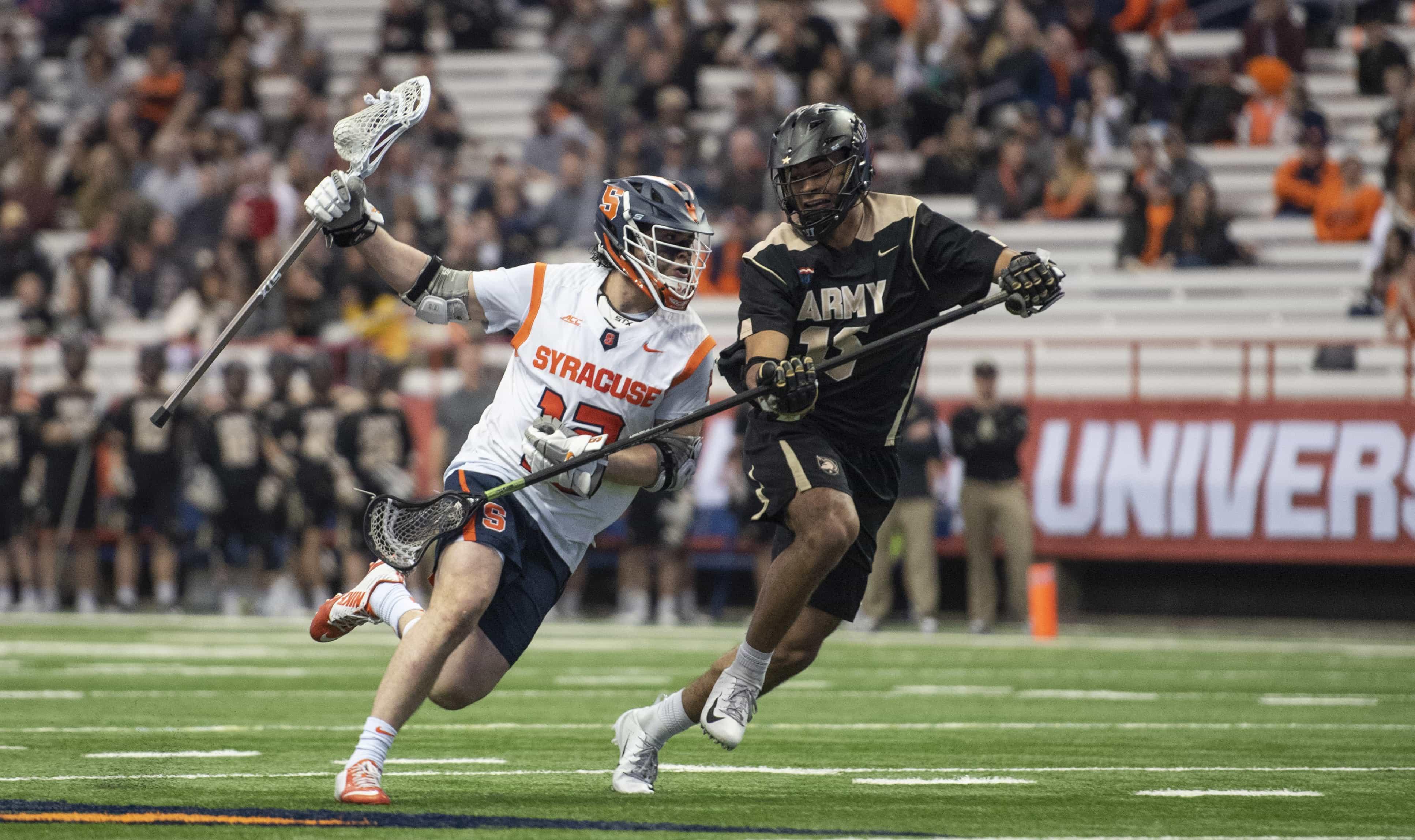 Freshman Pete Fiorini runs around an Army defender.